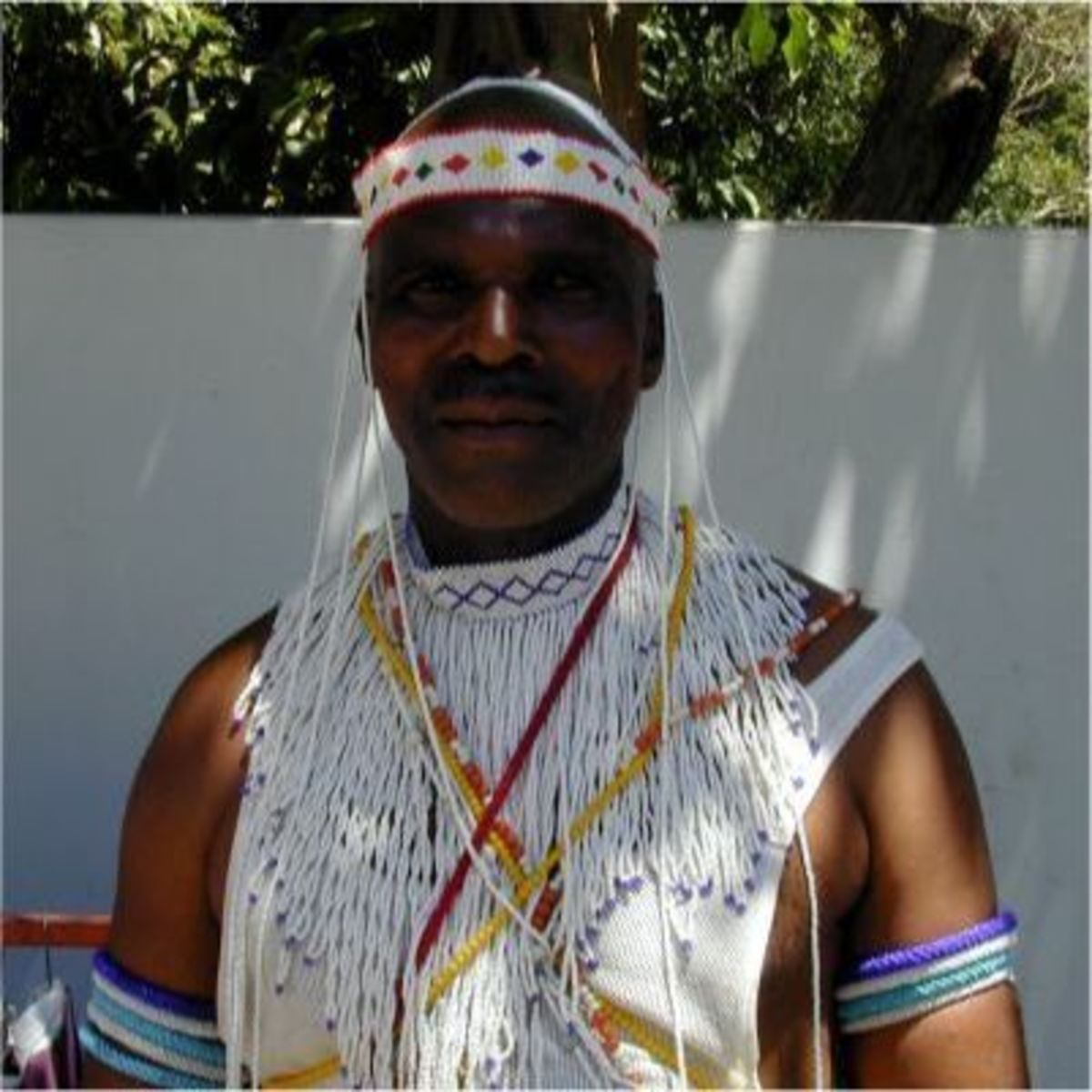 A xhosa man clad in clan garb