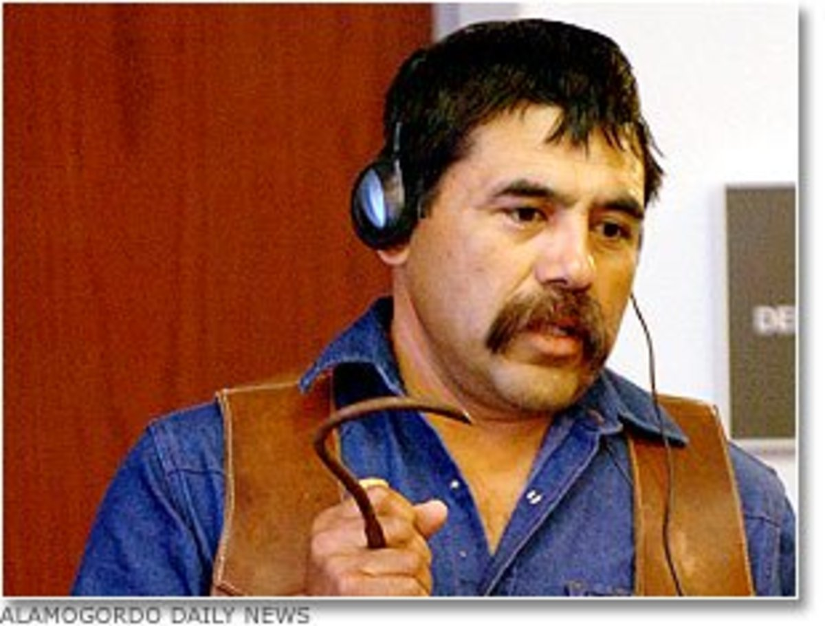 Ranch hand Pilo Vasquez, who witnessed Paul's cruelty towards Cody, and corroborated Cody's claims of abuse during the trial.  He is demonstrating how Paul used the large metal hook to inflict pain on Cody.