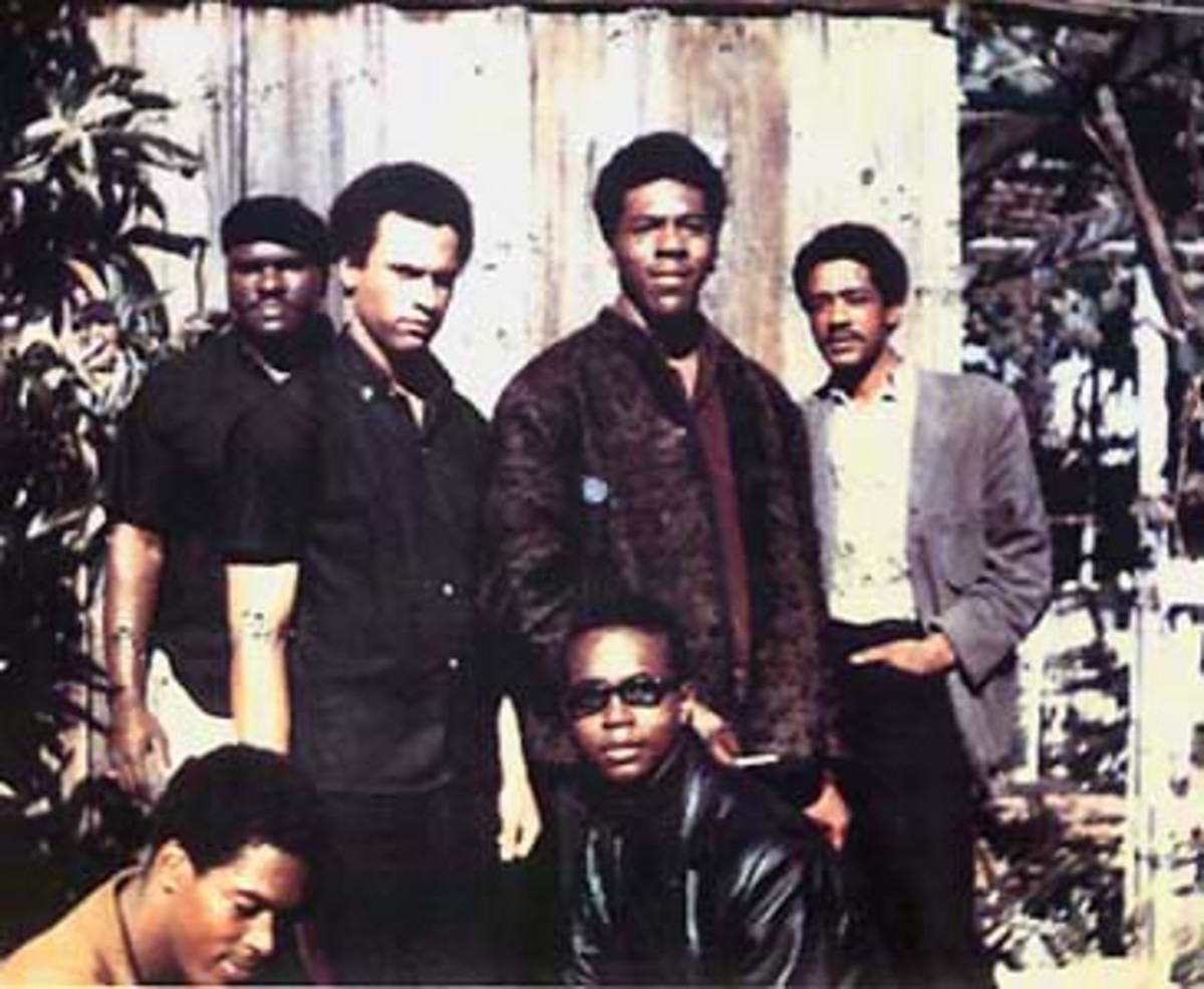 """Original six members of the Black Panther Party (November, 1966) Top left to right: Elbert """"Big Man"""" Howard; Huey P. Newton (Defense Minister), Sherman Forte, Bobby Seale (Chairman). Bottom: Reggie Forte and Little Bobby Hutton (Treasurer)"""