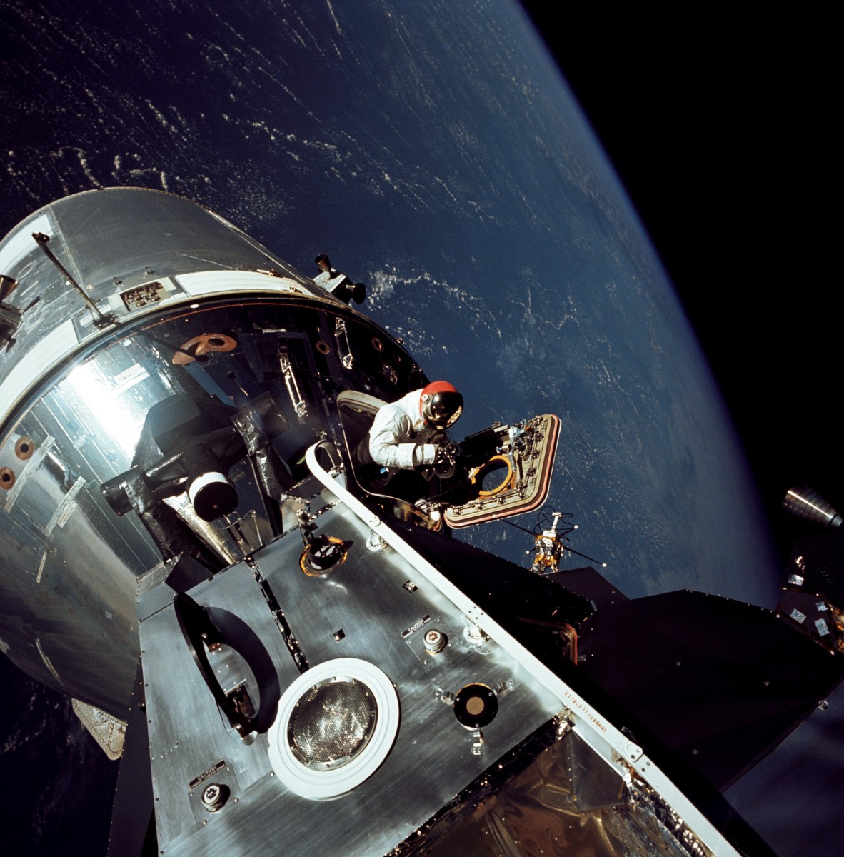 Apollo 9 astronaut Dave Scott photographed on March 6, 1969. His crewmate Rusty Schweickart, lunar module pilot, took this photograph from the porch of the lunar module.