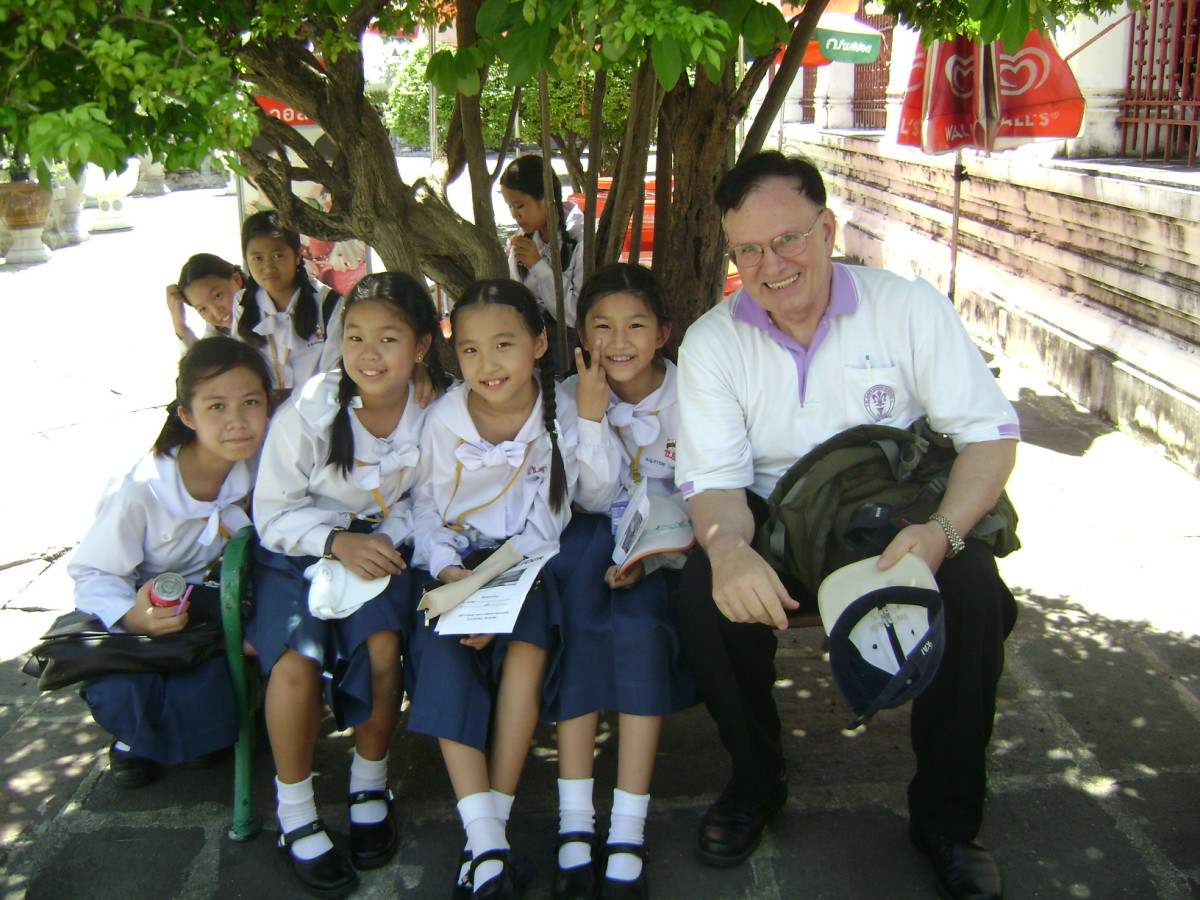 The author as a Catholic school teacher in Thailand on a field trip with sixth grade students.  Photo taken in 2011.