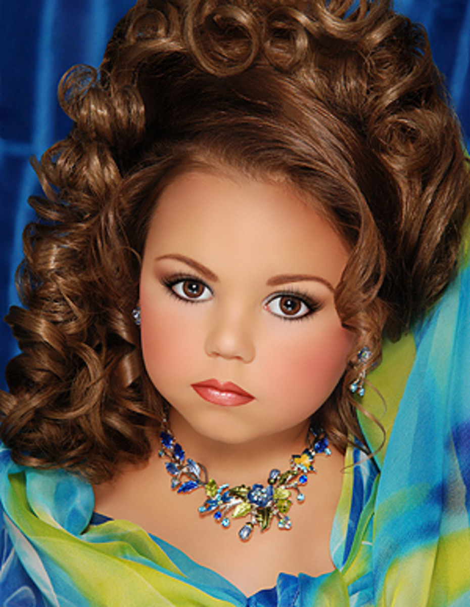Another Toddlers and Tiaras star. This girl can't be more than five or six. All our girls are going to think they should look like this if we don't knock it off.