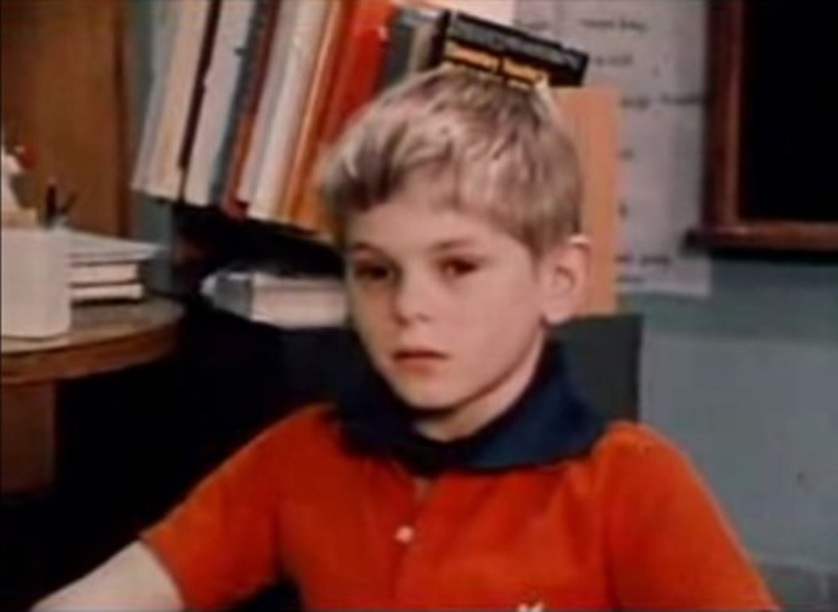 A brown-eyed boy wearing a collar