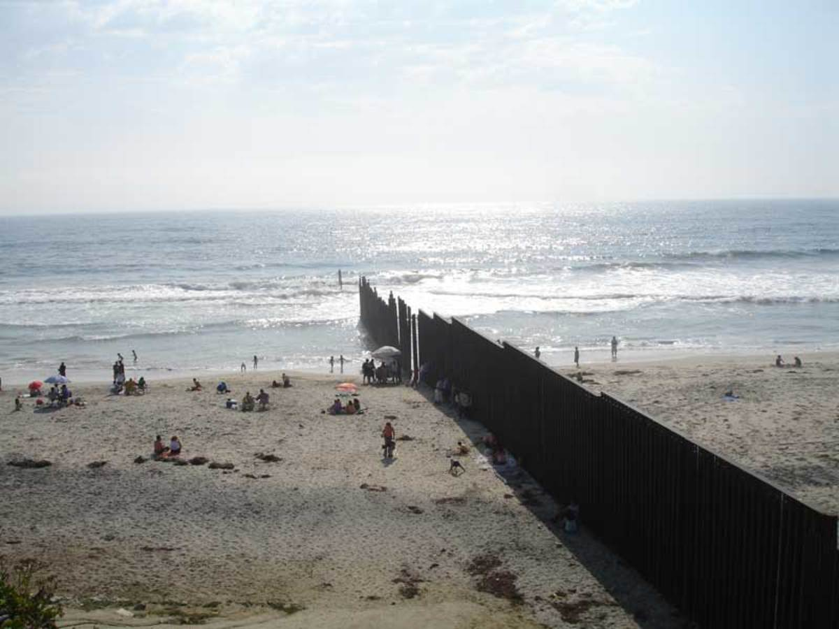 The beach at Tijuana viewed from the Mexican side of the border.  The Pacific Ocean can be seen as well as the barrier that marks the border.  Amnesty critics often argue that more preventative means need to be in place to stop illegal immigration.