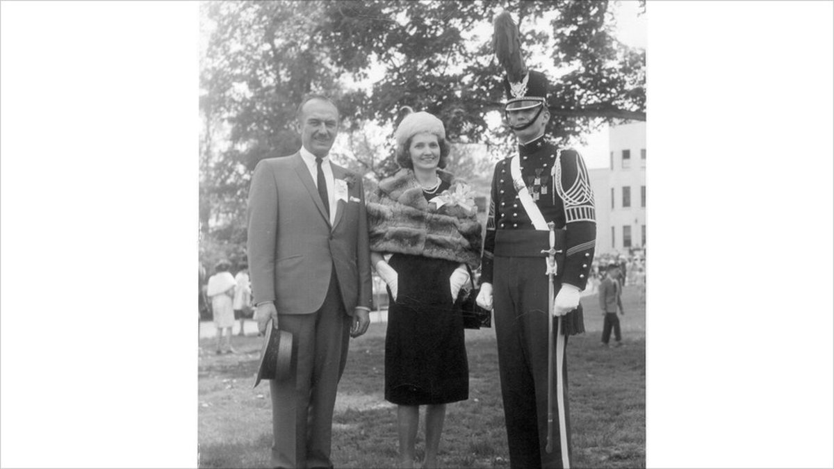 With his parents at his graduation from military school