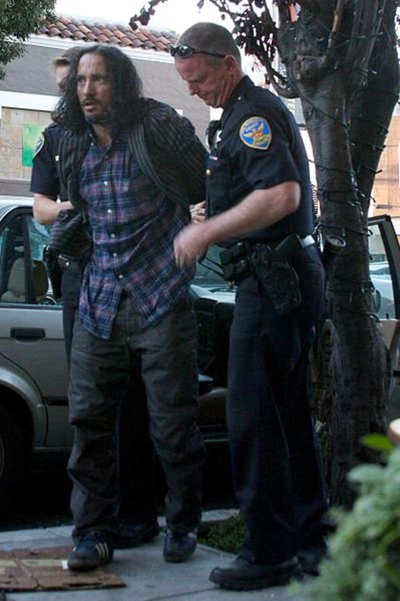 A man being arrested for Methamphetamine possession in San Fransisco, California.