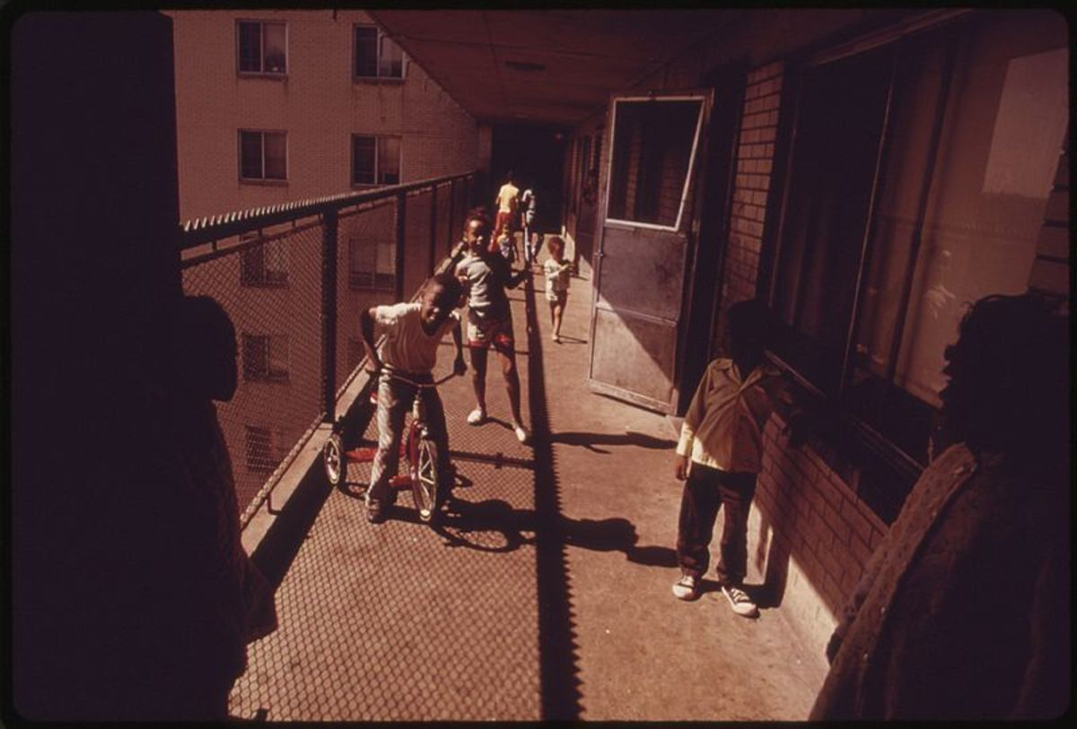 Residents on one of the balconies of the Robert Taylor homes, a low income, high-rise apartment building in Chicago.