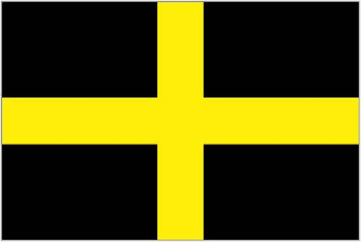 St David's Cross. Unlike the other nations, the Patron Saint of Wales doesn't provide Wales with its national flag. The Red Dragon is favoured, though the black and yellow colours could one day contribute to a redesigned Union Jack (see later)