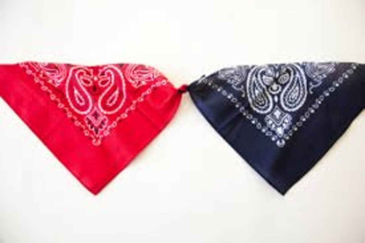 """UNITE"" Bandannas tied together. Red, blue, and white are the colors of the American flag (the white is the KKK!)."