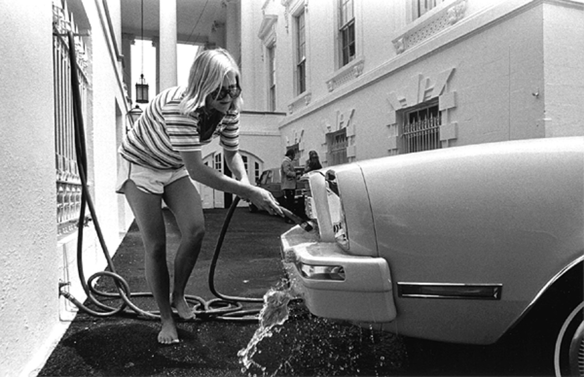 Susan Ford Washing Her Car at White House in 1976