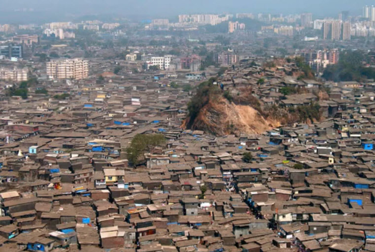 A Teaming Slum in Mumbai - Much of the World Lives in Overcrowded Slums and Shanty Towns, because there are too many people.
