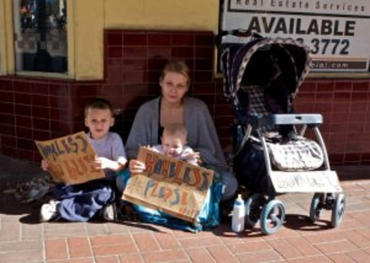 A homeless family begs for food on a street somewhere in the richest nation on Earth.