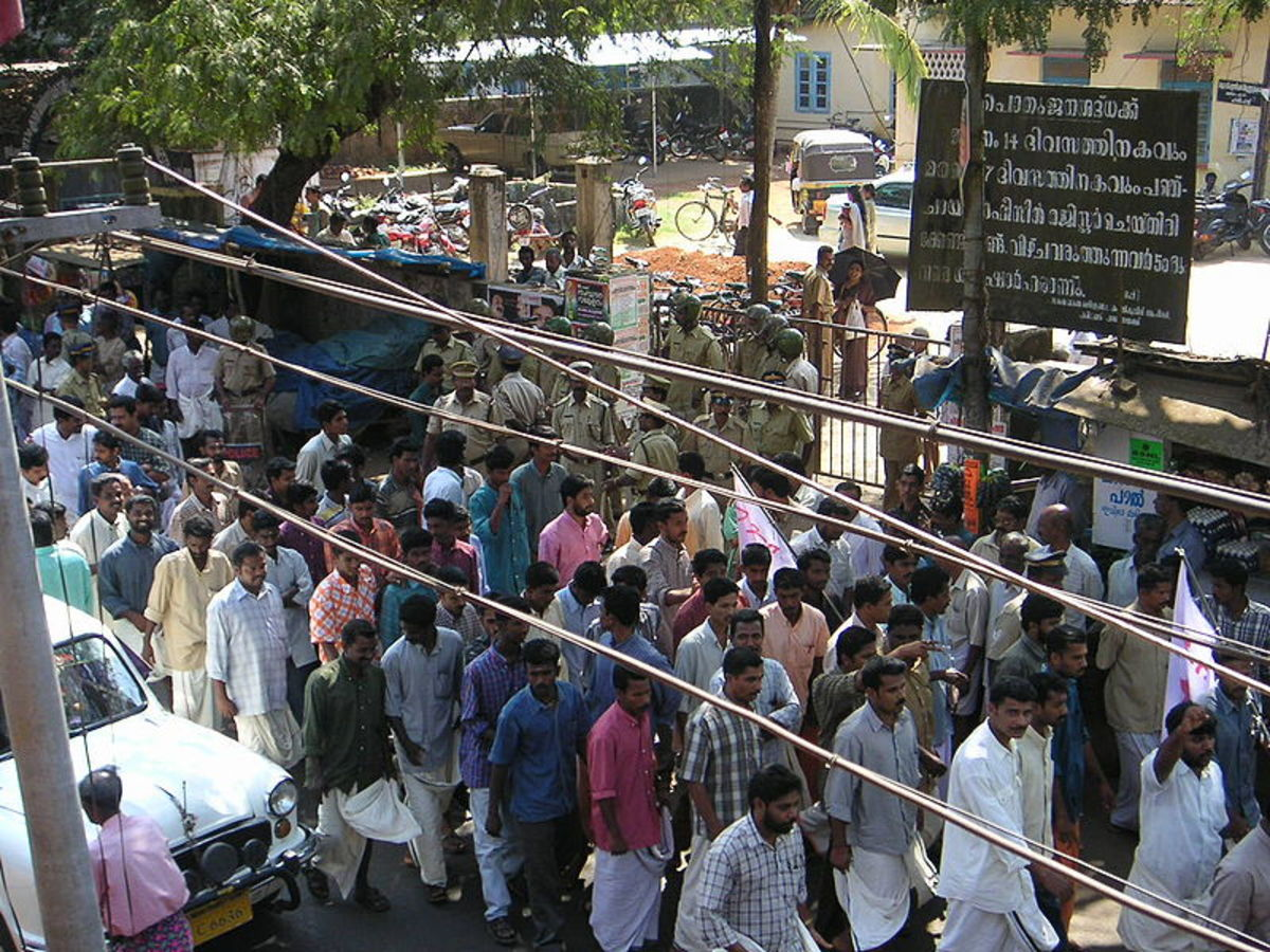 "Demonstration against unemployment in Kerala, India. ""Dyfiharipadarally (32)"". Licensed under Creative Commons Attribution 2.5."