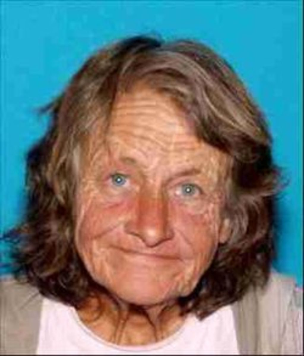 Violet Phillips, 67, homeless, was set on fire as she slept on a bus stop bench.