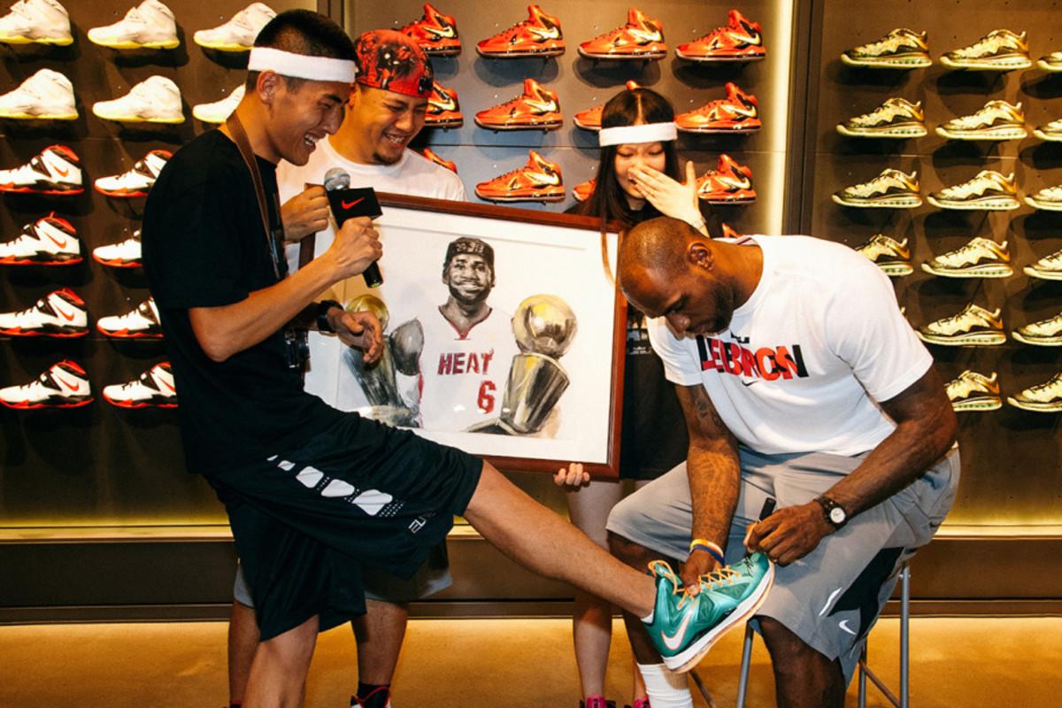 Basketball legend Lebron James visits a Nike factory.