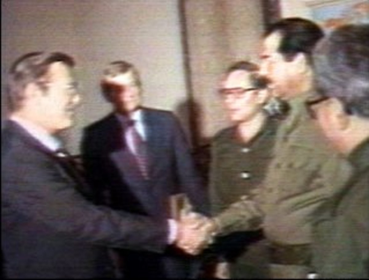 Iraqi President Saddam Hussein greets Donald Rumsfeld, special envoy of President Ronald Reagan, in Baghdad on December 20, 1983.