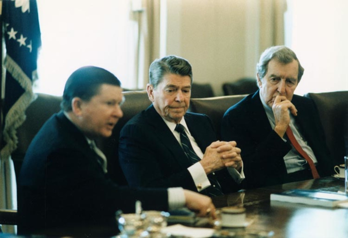 Ronald Reagan in the cabinet room, discussing Iran-Contra with John Tower and Edmund Muskie.