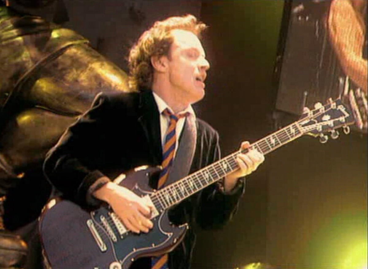 Angus Young from heavy rock band, AC/DC wears a school uniform as part of his stage act.