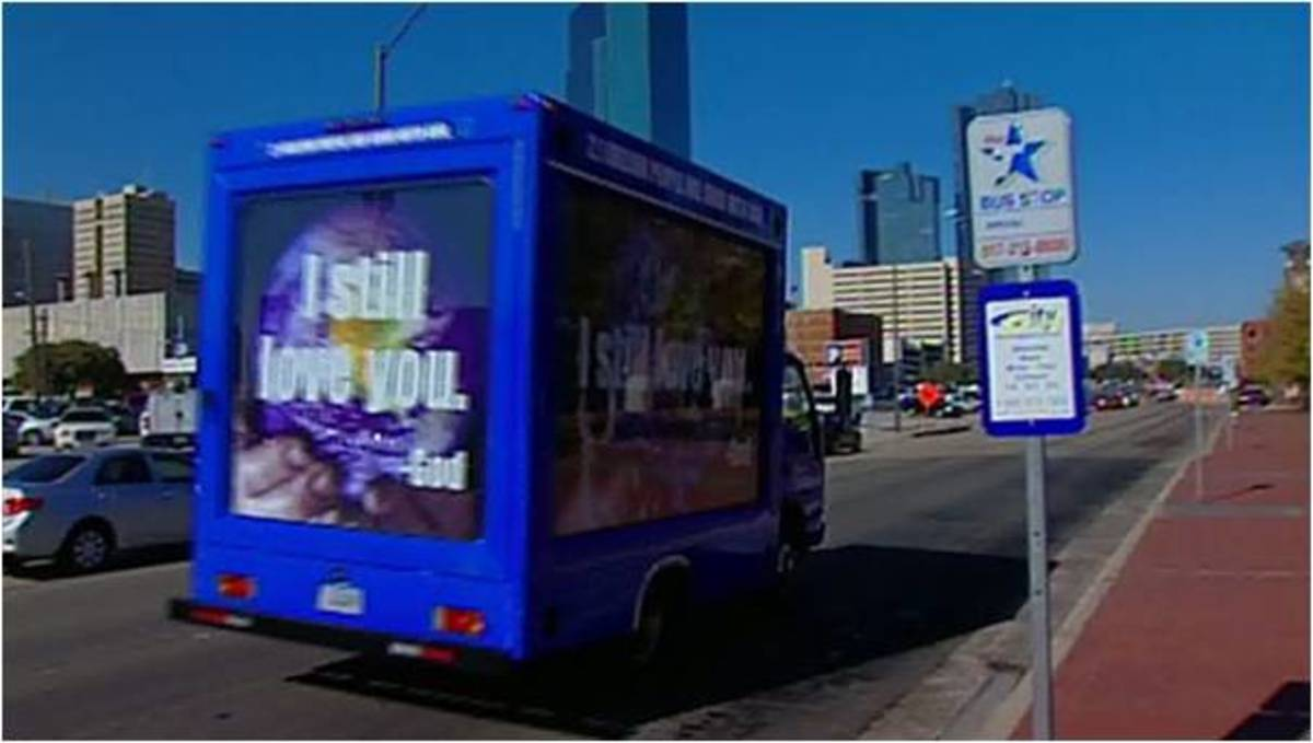 "A private bus follows the Dallas-Fort Worth city bus with the ""good without God"" message."