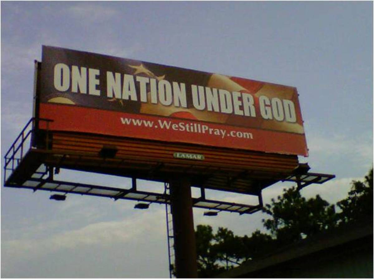 "A billboard proclaims ""One Nation Under God."""