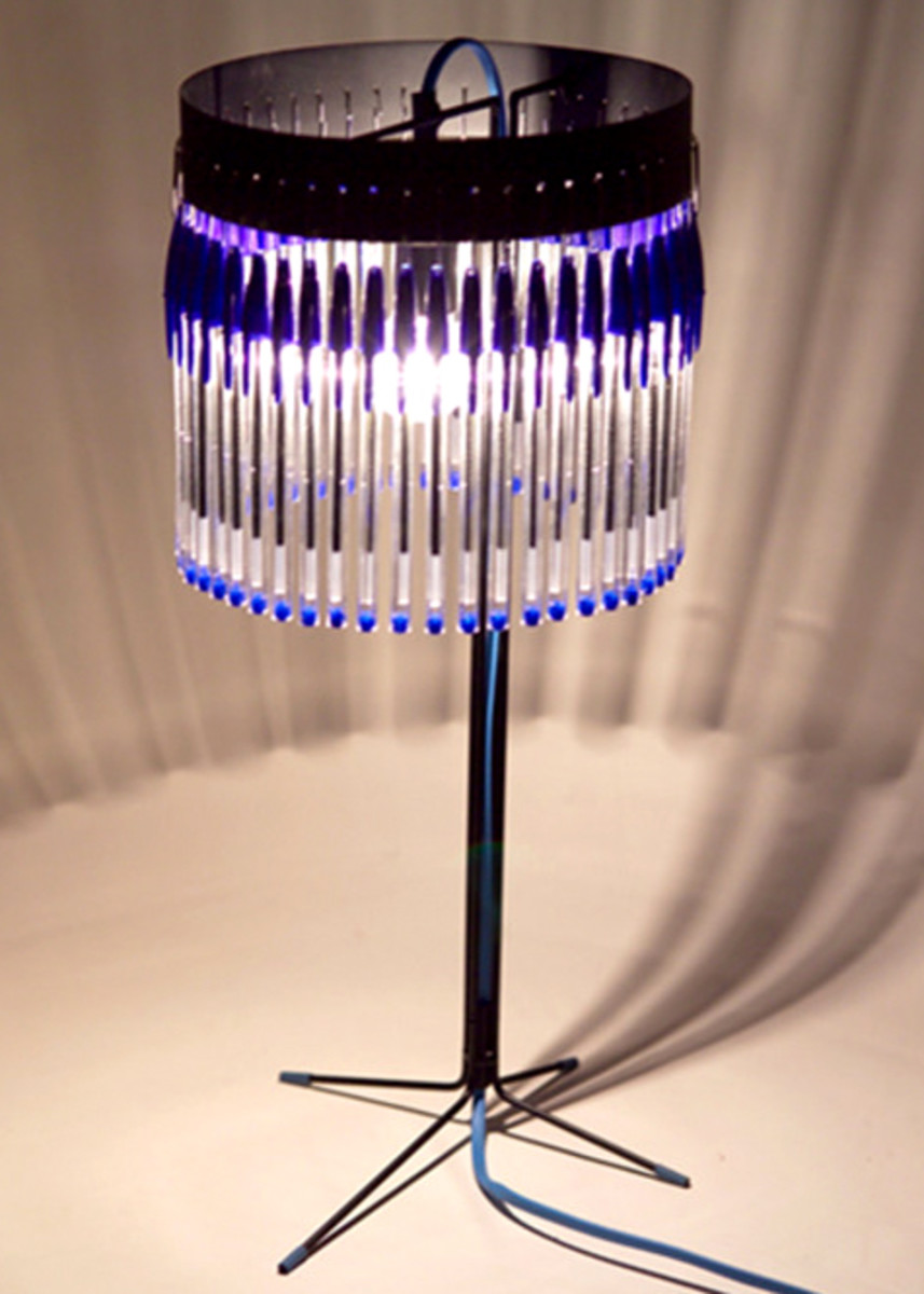 A stunning lamp shade designed by En Pieza. But look a bit closer - it's made out of a whole lot of old ball point pens