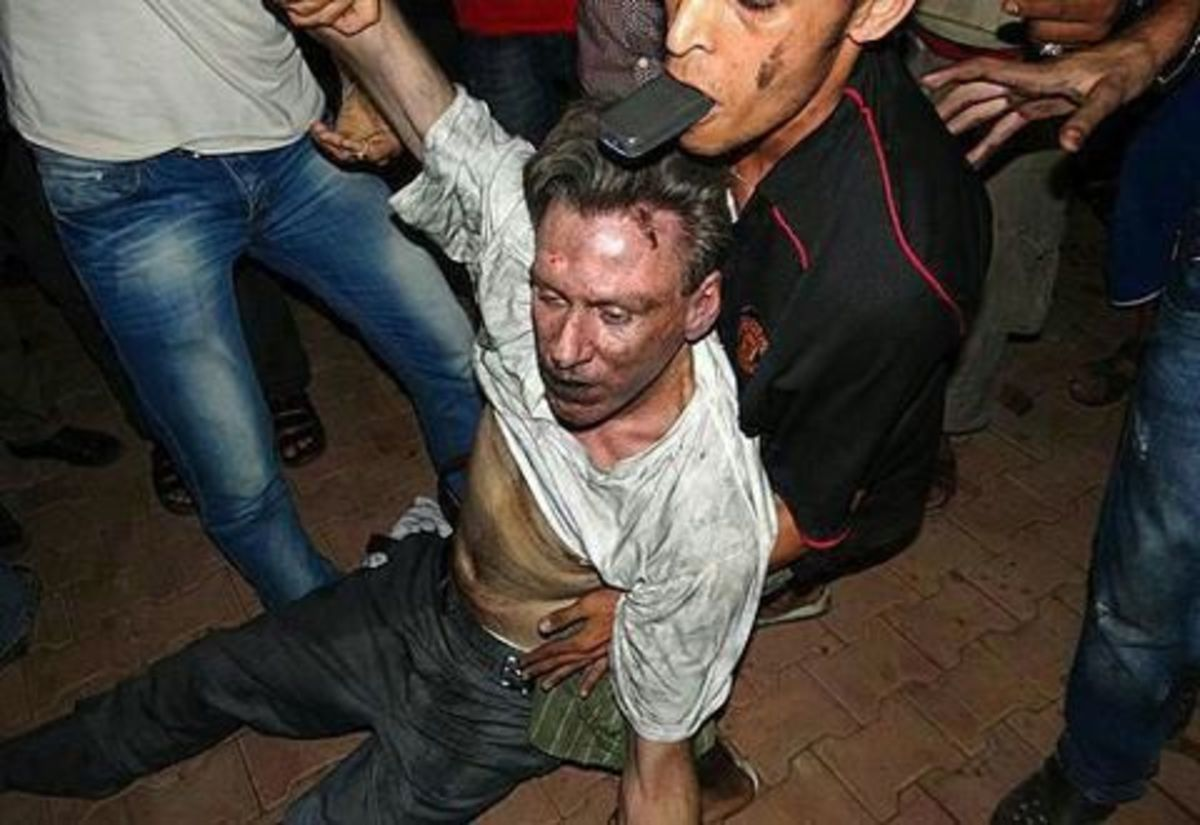 Ambassador Chris Stevens being taken to the hospital by his Libyan rescuers.