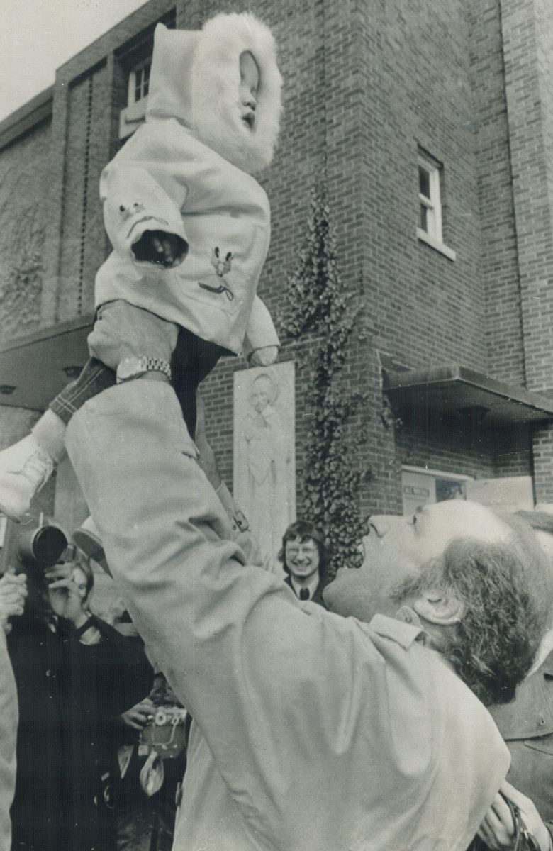 Pierre swings a young Justin after leaving an Ottawa polling station.