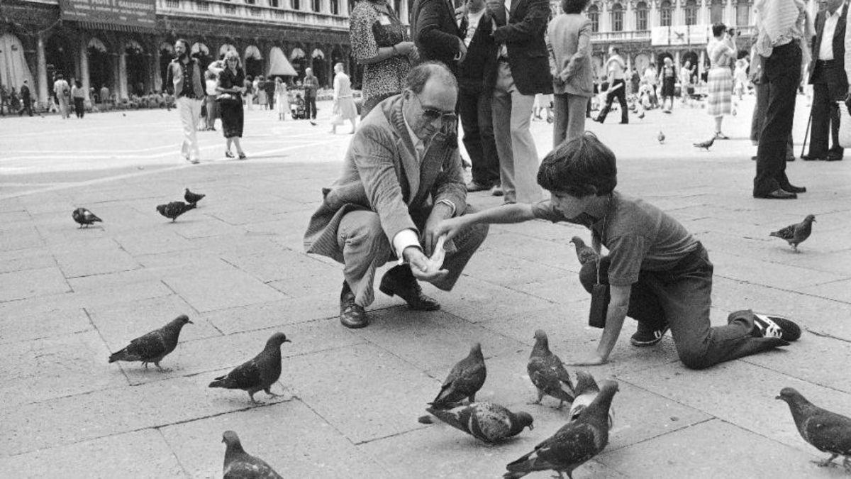 Feeding the pigeons St. Mark's Square in Venice, Jun 21, 1980.