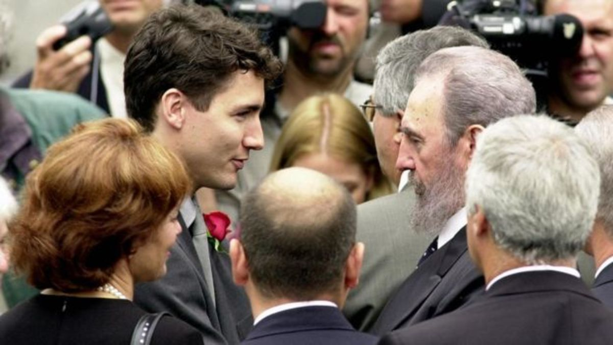 Cuban President Fidel Castro attends the funeral for Pierre Trudeau