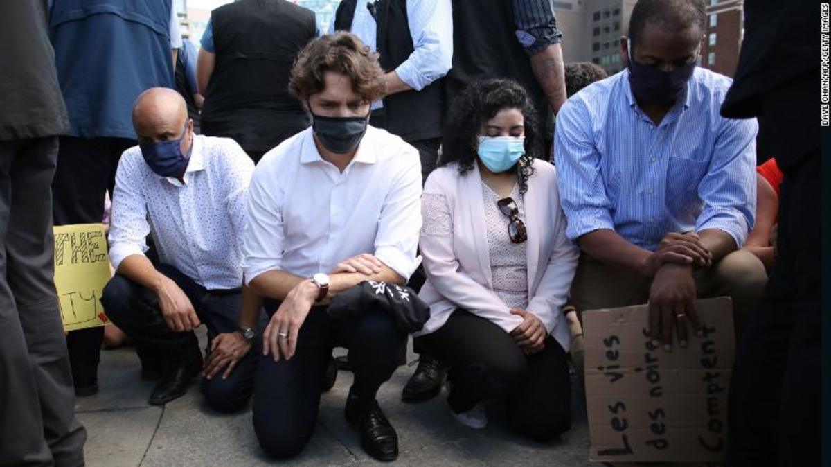On Parliament Hill, Trudeau and his ministers joined a Black Lives Matter march and took a knee in solidarity with the demonstrators, Jun 2020.