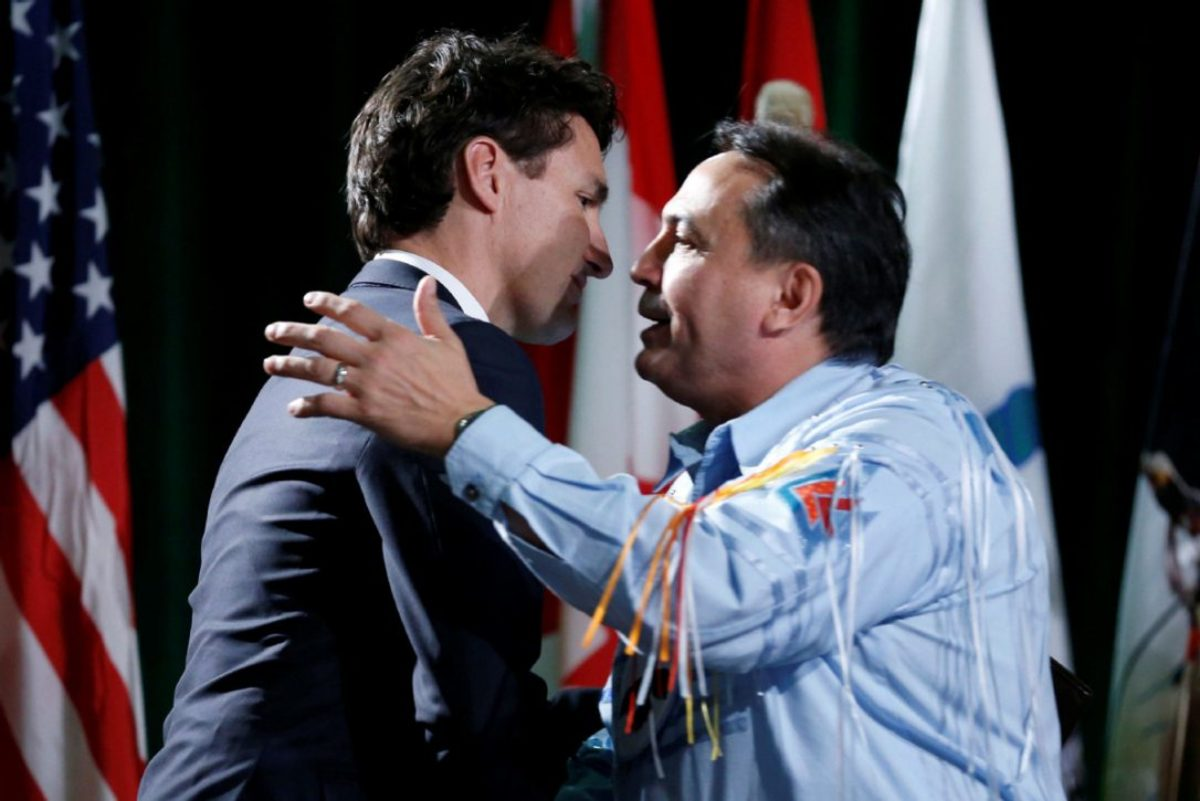 Prime Minister Justin Trudeau  embraces Assembly of First Nations National Chief Perry Bellegarde at the Assembly of First Nations Special Chiefs Assembly in Gatineau, Quebec, Canada (Dec 6, 2016)