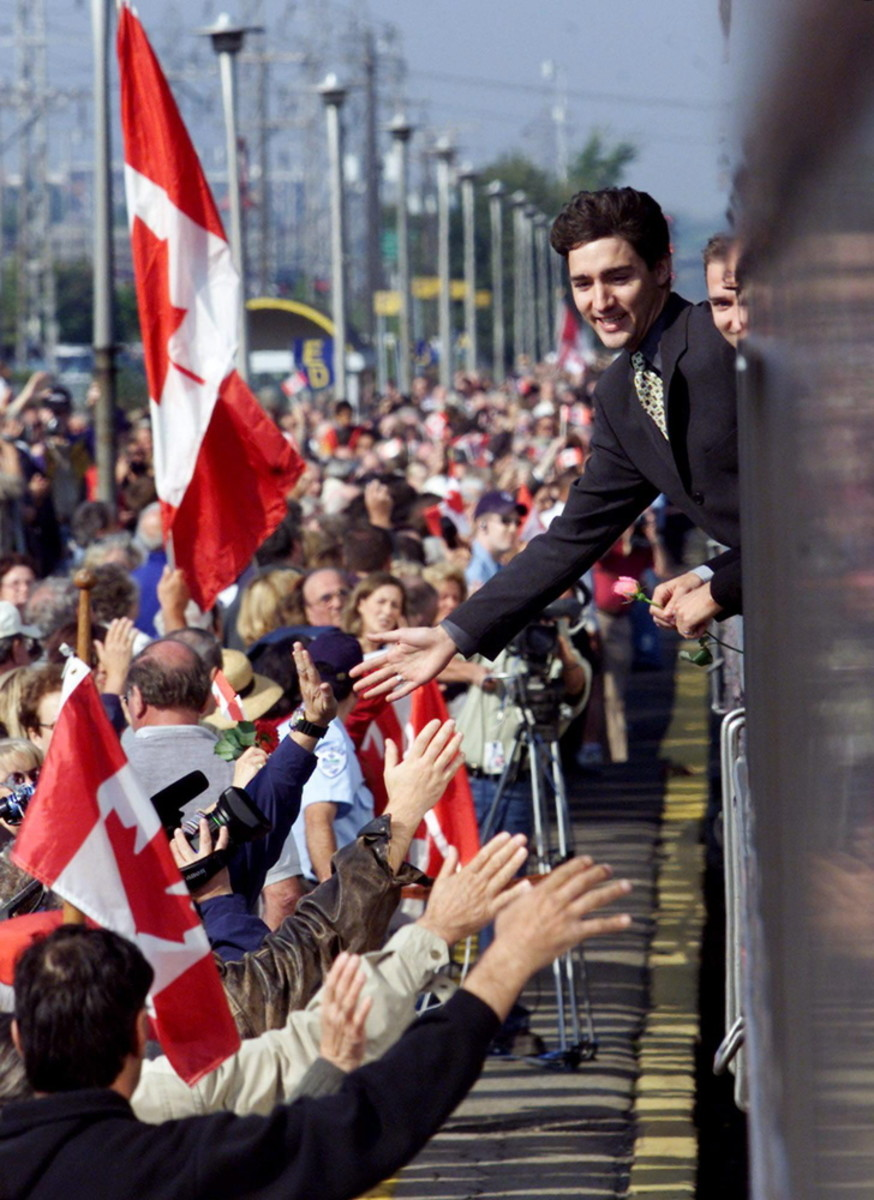 Justin and Alexandre (Sacha) Trudeau lean out of the funeral train to show appreciation to mourners who turned out to pay their respects to former prime minister Pierre Trudeau in Dorval, Quebec (Oct  2, 2000).