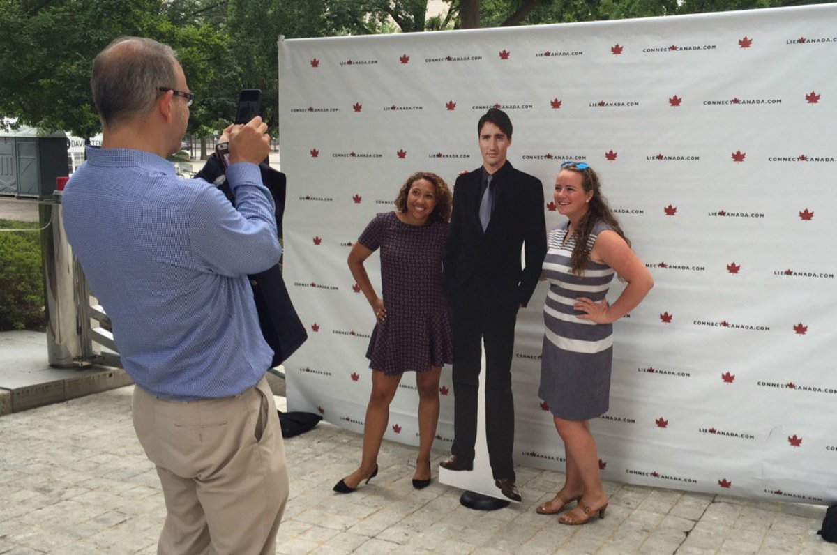 Visitors to the Canadian Embassy (in Washington DC) pose with a Trudeau cut-out on Canada Day 2016.