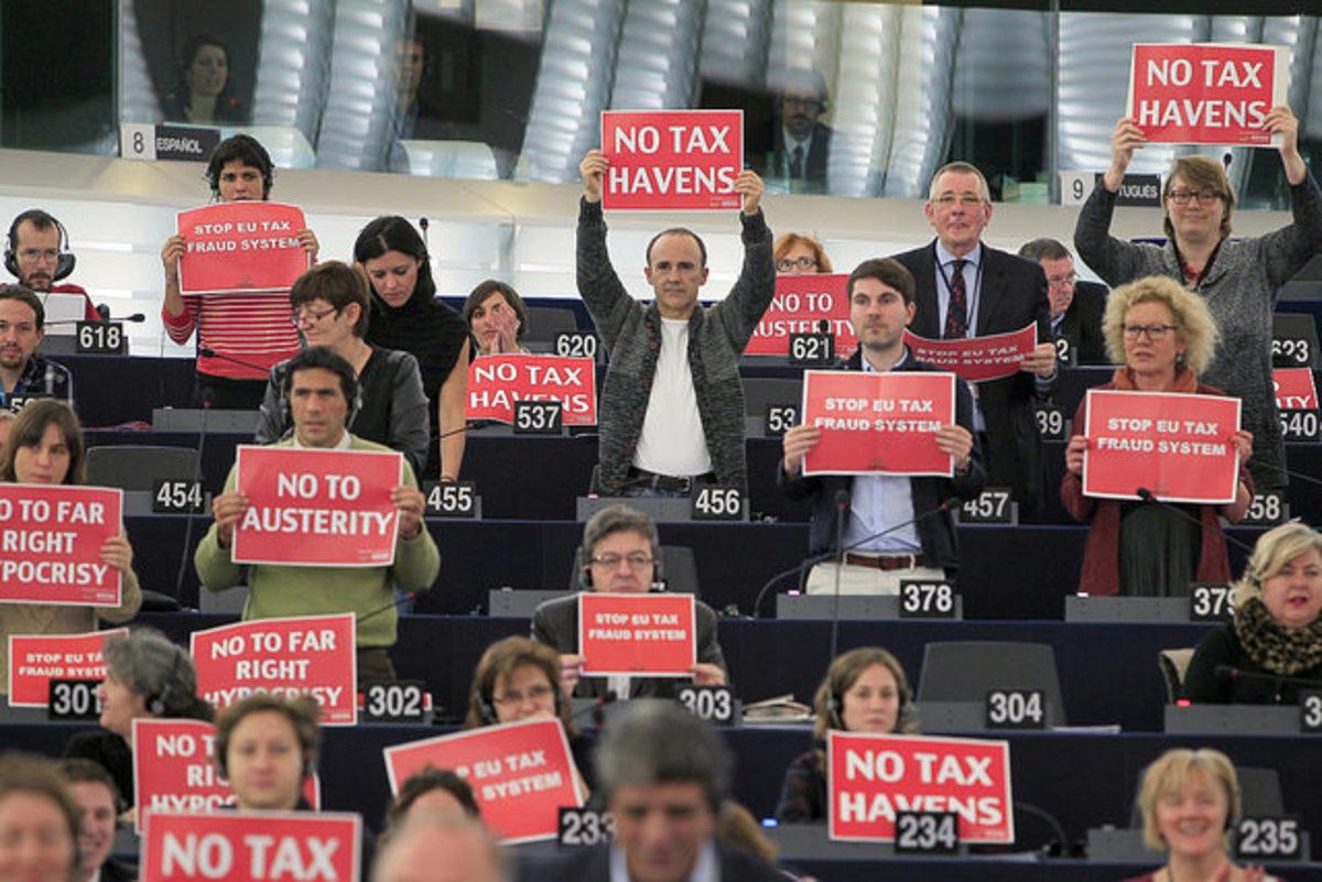 Members of a coalition of leftist legislators protest in the European Parliament.