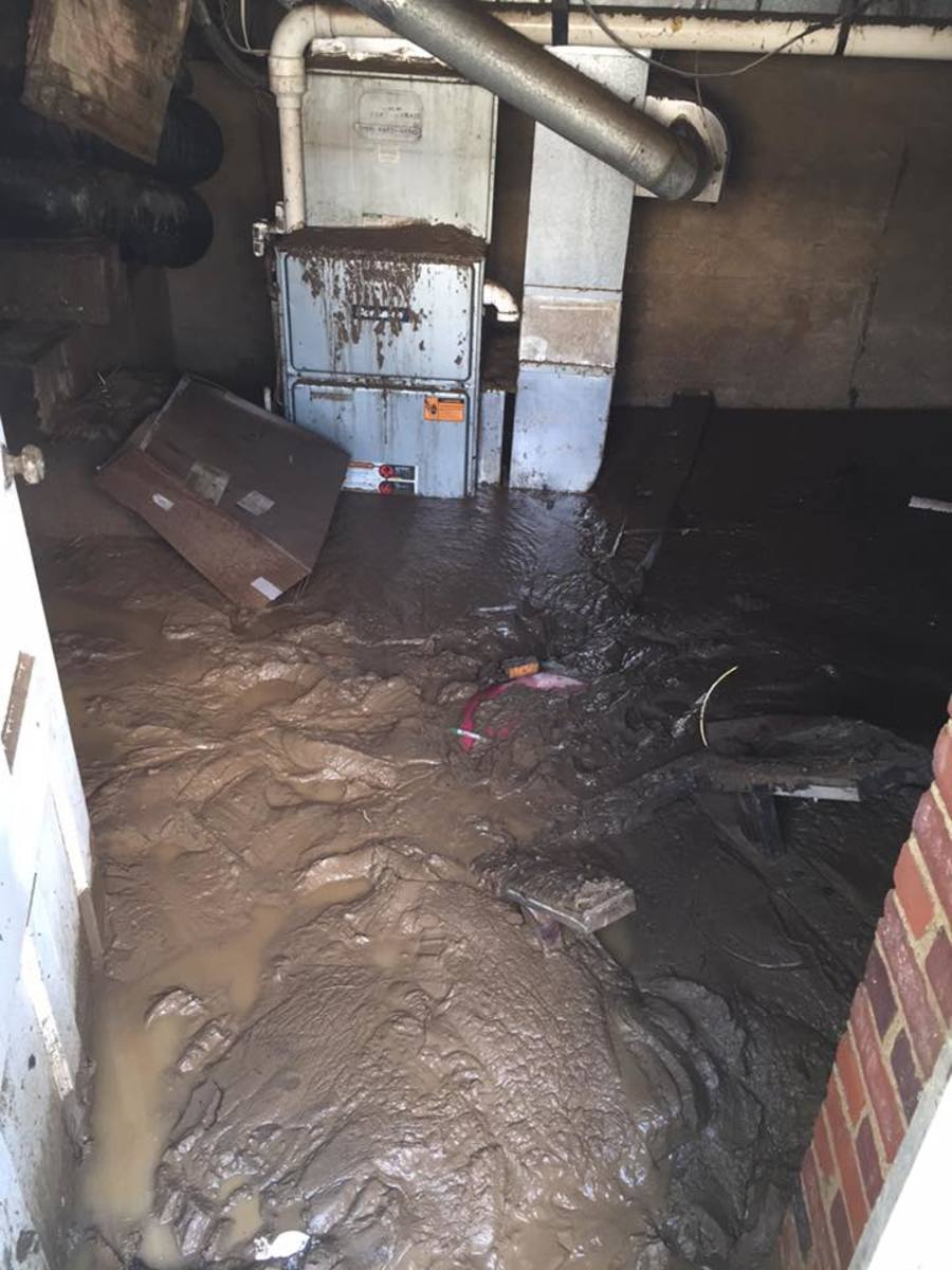 As waters receded the amount of mud left behind inside homes was a staggering site.