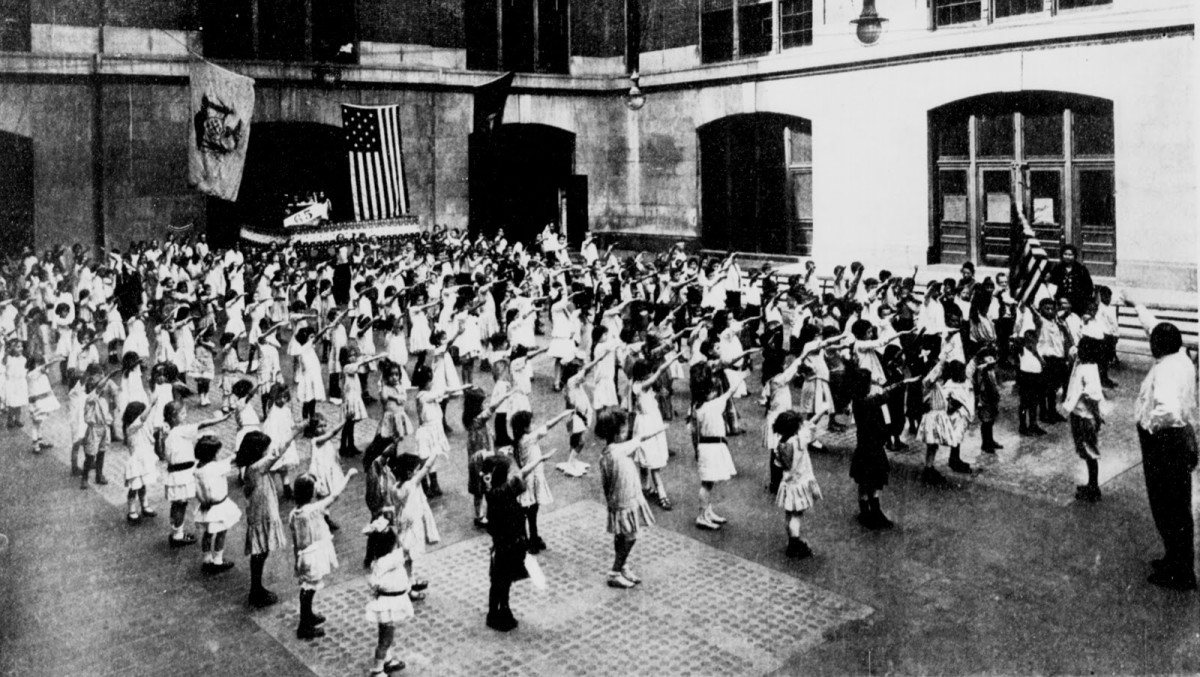 "American school children doing the pledge, before Germany co-opted the whole ""Hail Hitler"" thing"