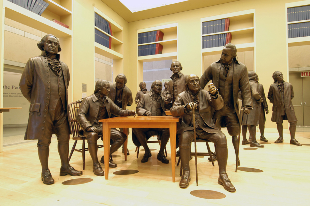 Some of the 42 bronze figures of the signers of the U.S. Constitution, at the National Constitution Center, Philadelphia, PA
