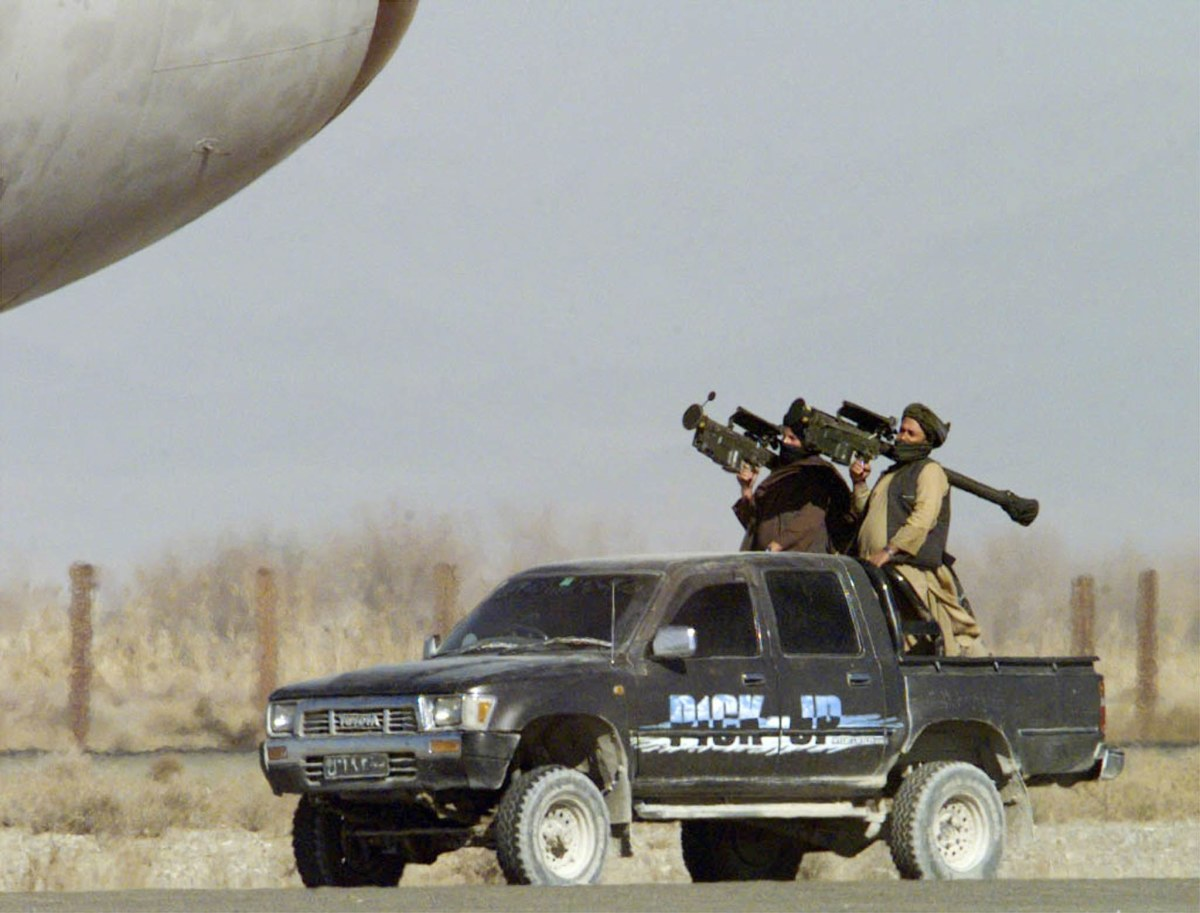 Taliban militants armed with surface to air stinger missiles, guarding the hijacked IC 814