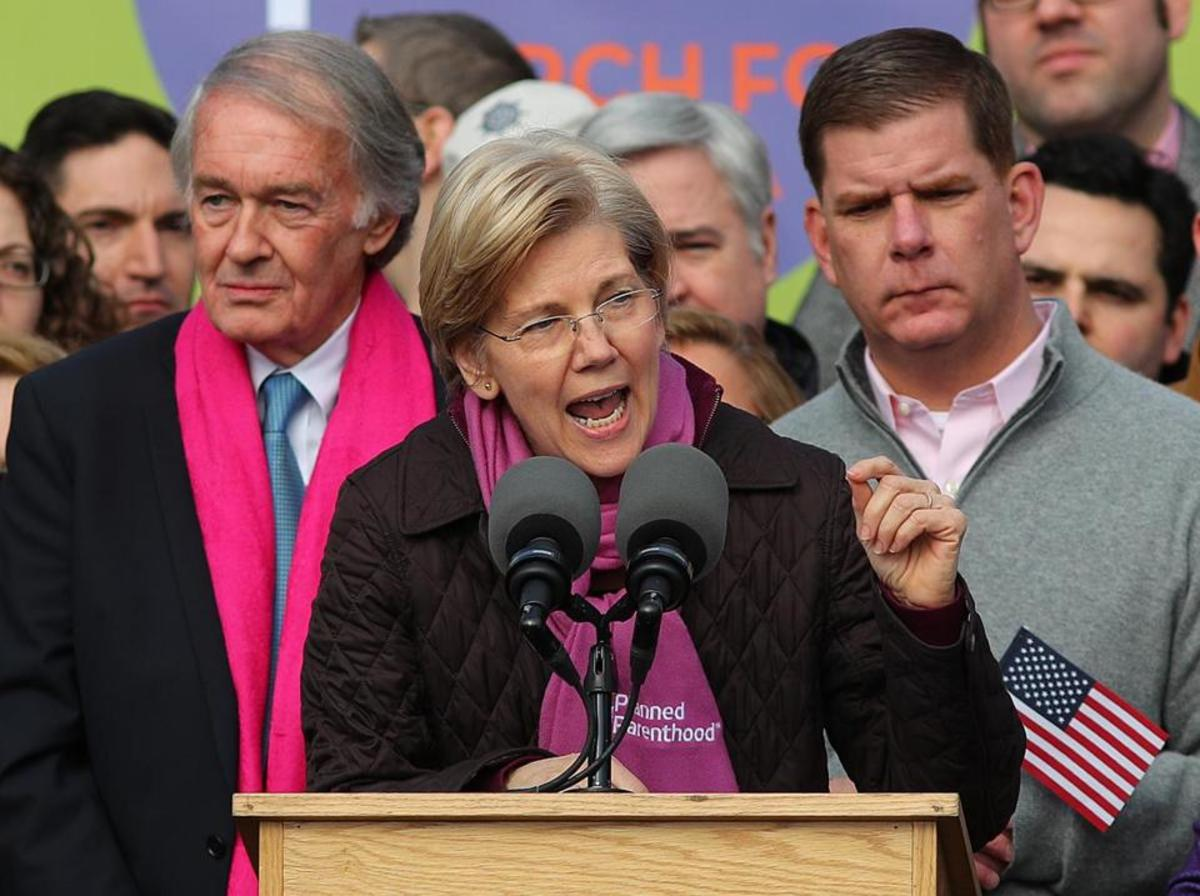Elizabeth Warren, wearing a Planned Parenthood scarf, addresses the crowd at the Women's March on Boston