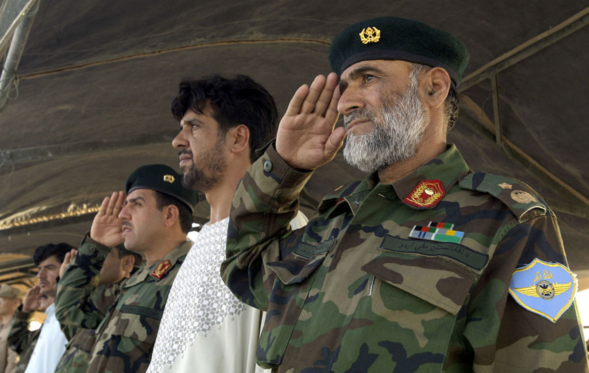 Afghan National Army Air Corps Brig. Gen. Mohammad Yousaf renders honors July 31, 2007 during a historic change-of-command ceremony at Kandahar Air Field, Afghanistan