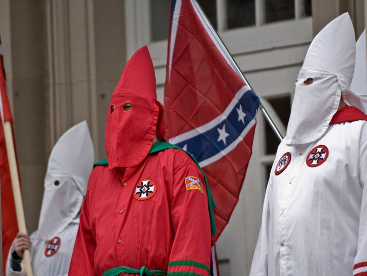 Ku Klux Klansmen with the Confederate flag
