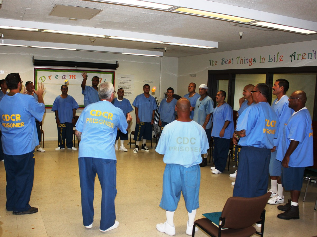 A men's group practices a Light and Lively.