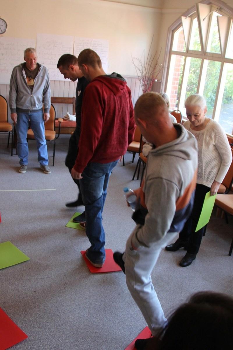 A group navigates their way through an exercise.