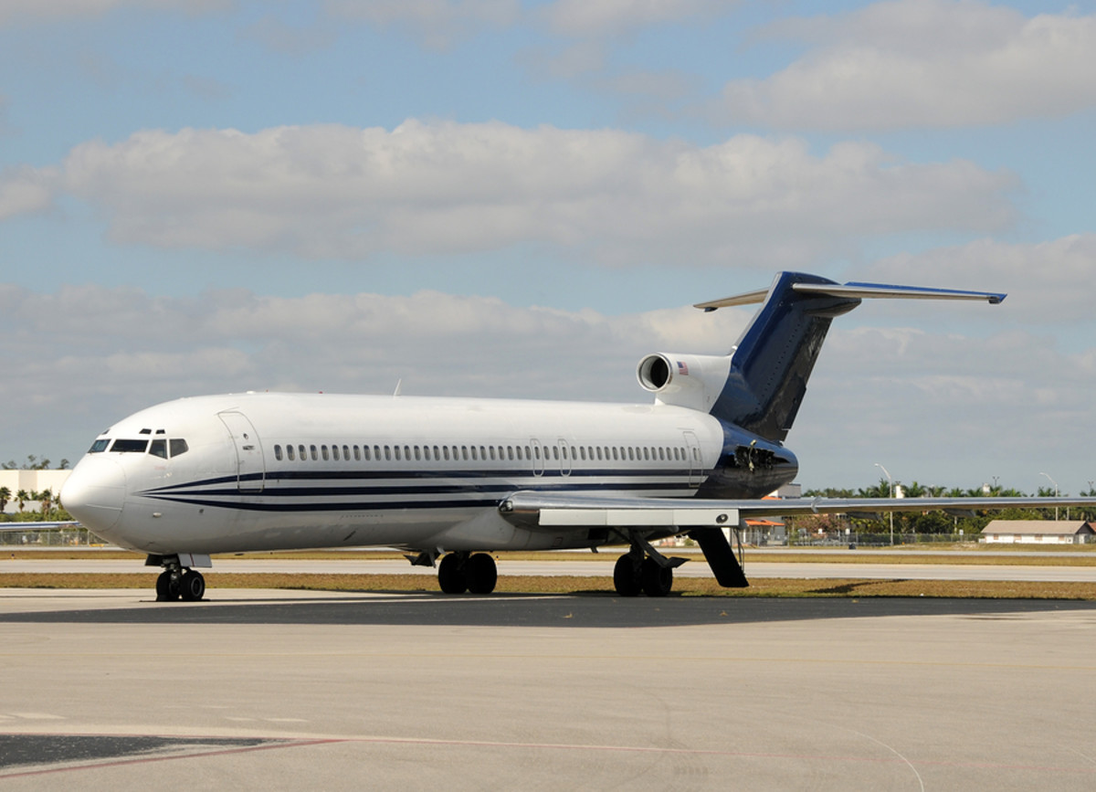 A Boeing 727 with its rear airstairs extended.