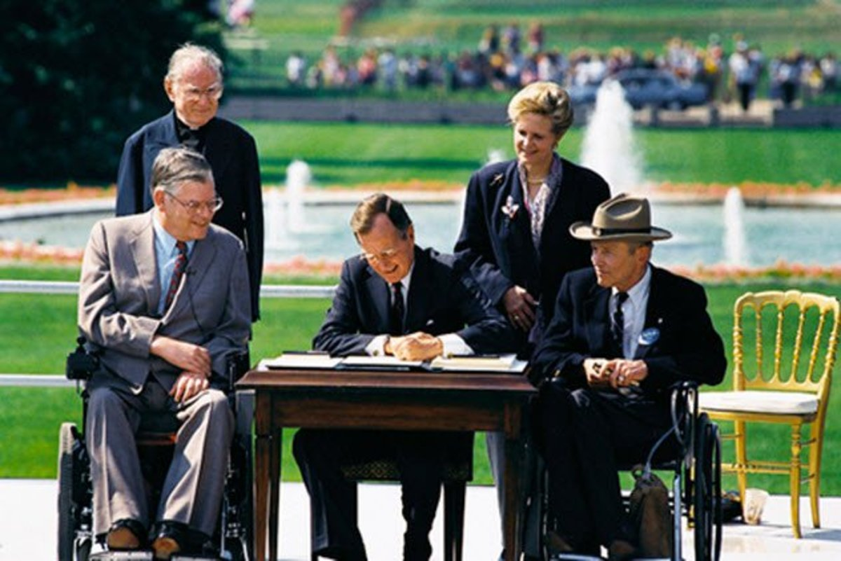President George H.W. Bush signs the ADA into law.