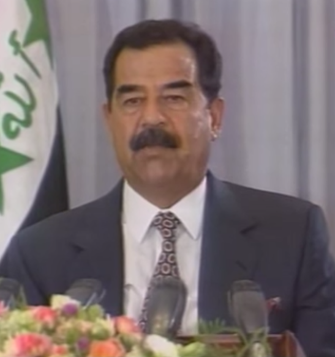 Iraqi President Saddam Hussein giving a speech about Saudi decision to allow American troops to stay in the country. 1996.