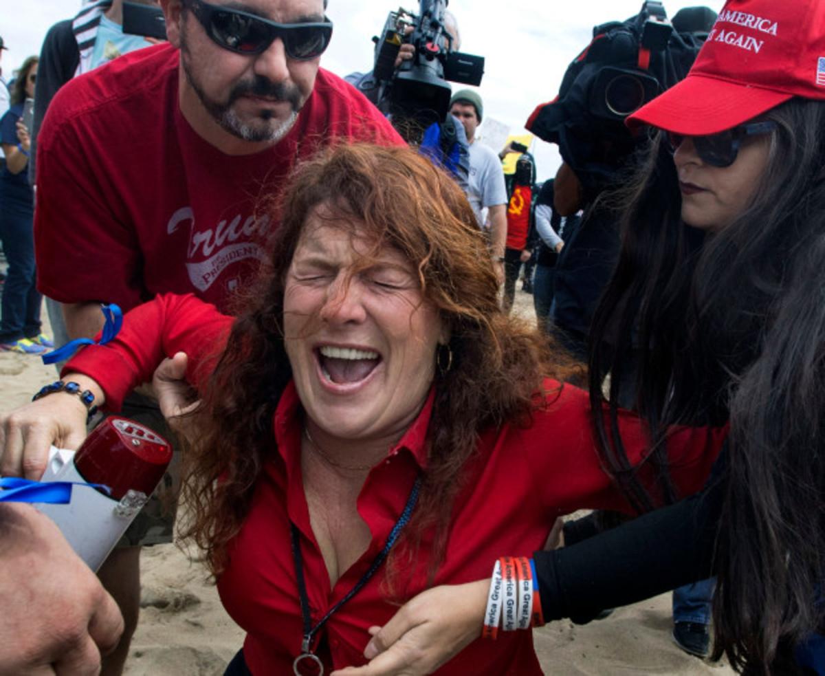 Woman pepper sprayed by Antifa at Huntington Beach Trump rally.
