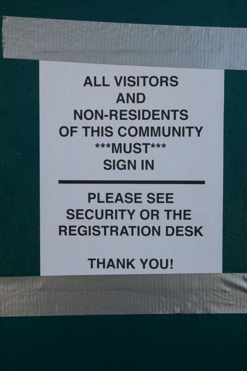 A sign asking visitors to sign in