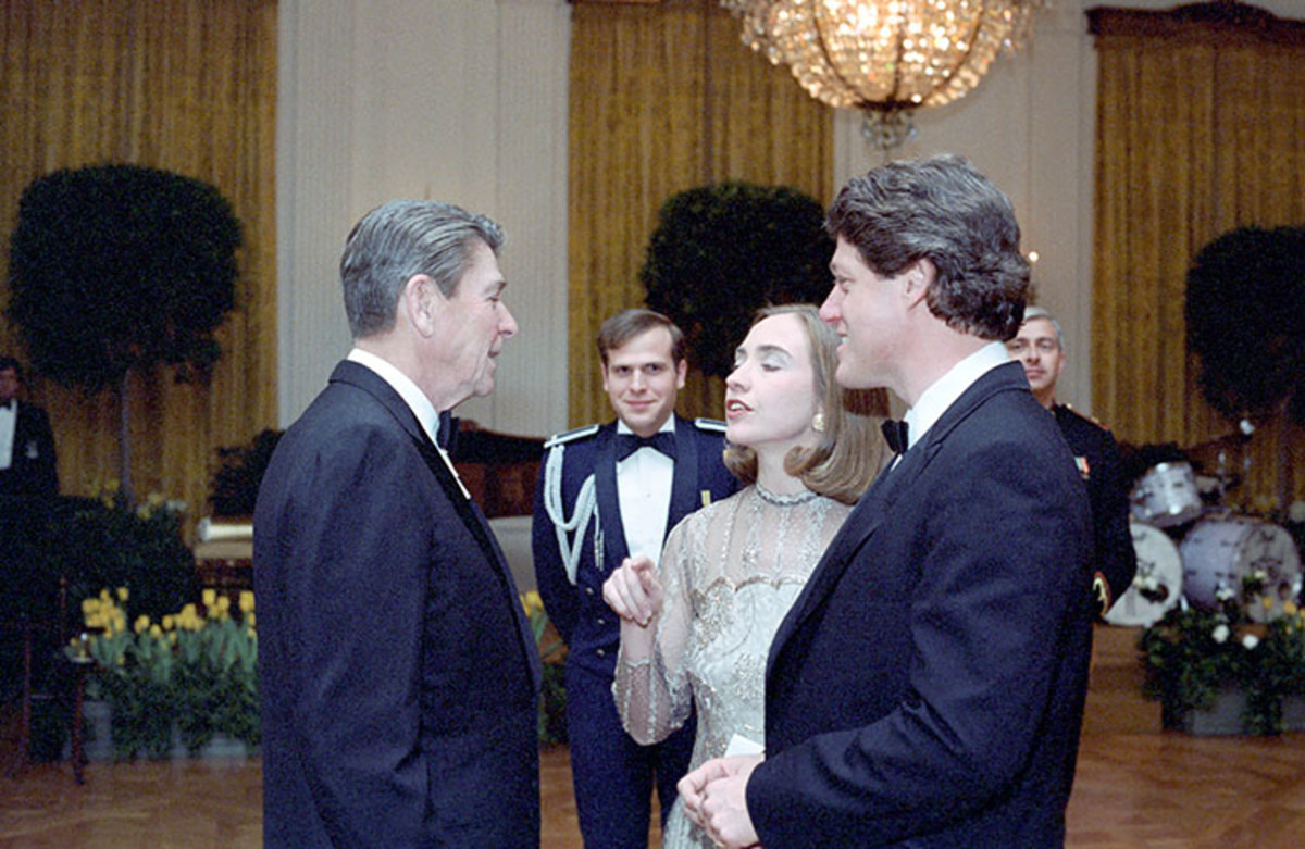 President Reagan with Bill Clinton and Hillary Clinton at a dinner in Honor of State Governors in the East Room in 1983.