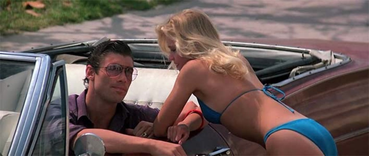 "A scene in the movie ""Scarface"" with Tammy Leppert as the distraction to Manny."
